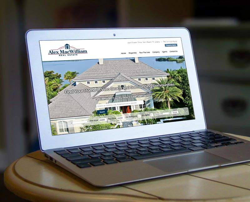 A PD/GO website, Alex MacWilliam Real Estate displayed on a laptop